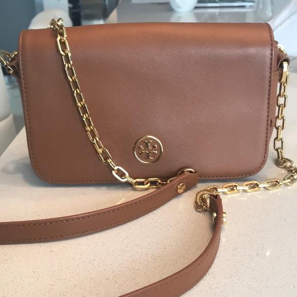 65f183d5f9d Tory Burch cross body bag light brown gold logo.  M 5c700046e944ba1ff54d599c. Other Bags ...